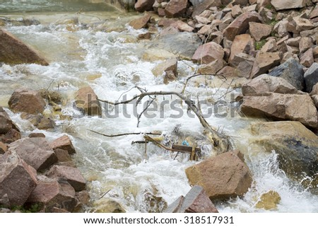 Mountain rocks and water flow  - stock photo