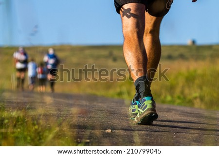 Mountain runners during morning workout - stock photo