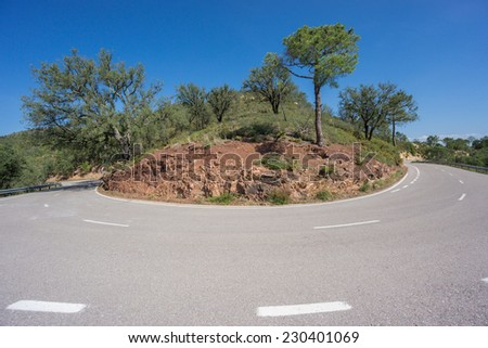 Mountain s-shape curved road, harpin bend worms eye view - stock photo