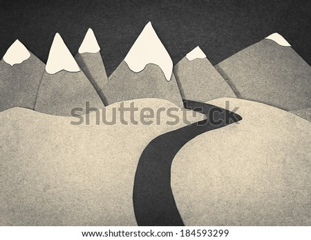 Mountain scene made out of cut cardboard - stock photo