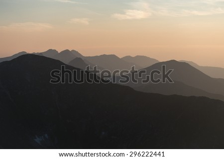 Mountain scenery at sunset with a series of peaks - West Tatras National Park, Slovakia, Europe