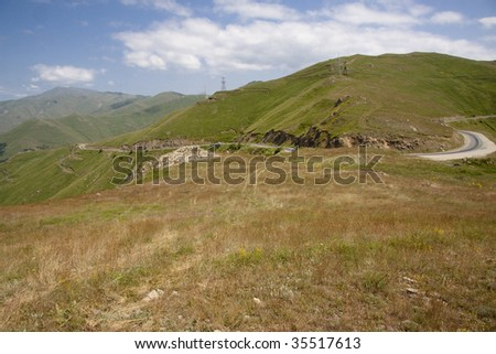 Mountain scenery in Armenia, route green meadows and blue sky. - stock photo