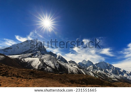 Mountain scenery in Himalaya with snow covered peaks - stock photo