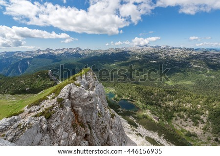 Mountain scenery with meadows, peaks and glacier lakes in the Alps - stock photo