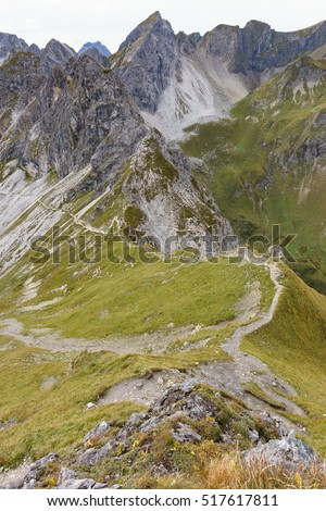 Mountain Scenery with paths on meadow in front in the Allgäu alps