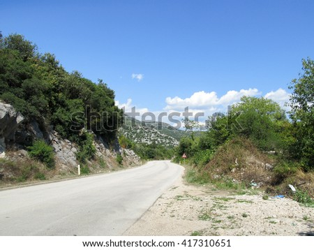 Mountain serpentine road view in the heart of Europe - stock photo