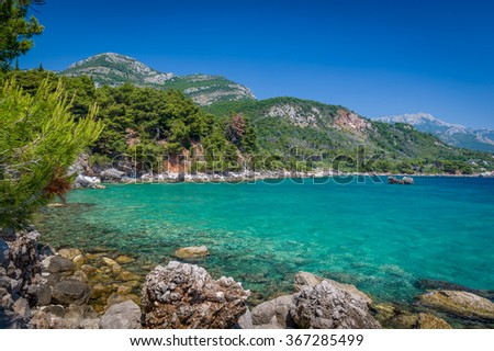 Mountain shore Adriatic sea landscape in a cloudless hot summer day. Sutomore, Montenegro.