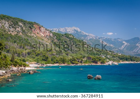Mountain shore of Adriatic sea at perfect calm and sunny summer day. Sutomore, Montenegro. - stock photo