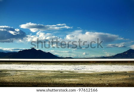 Mountain silhouettes landscape with Bonneville salt flats in northern Utah - stock photo