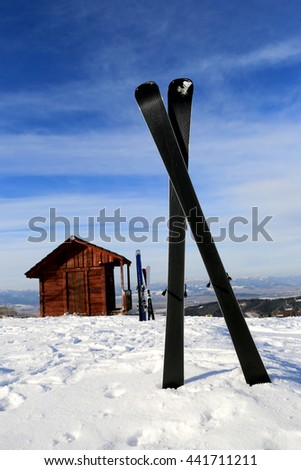 Mountain ski on snow in winter resort