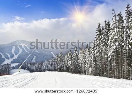 mountain ski resort under blue sky - stock photo