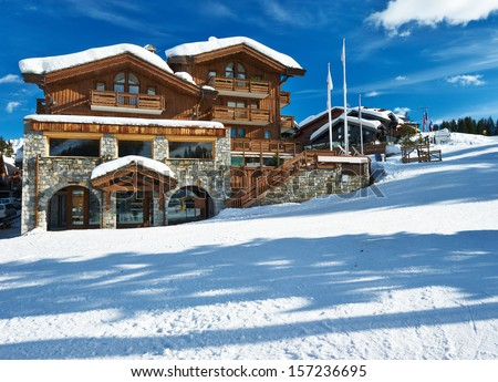 Mountain ski resort with snow in winter, Courchevel, Alps, France - stock photo