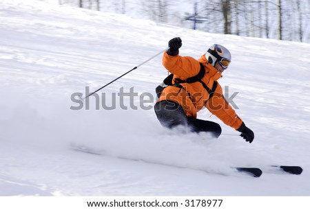mountain ski rider in orange sharp turn - stock photo