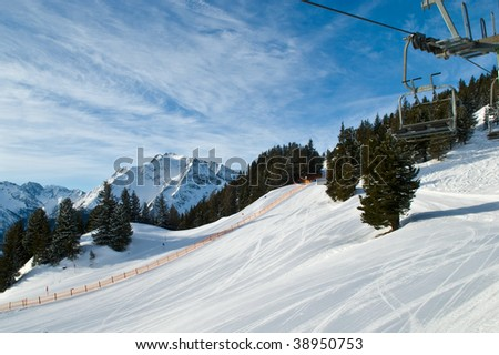 Mountain-skiing slope, snow, the ski lift, the bright sky