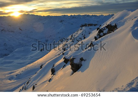 mountain snow fresh sunset at ski resort in france val thorens - stock photo