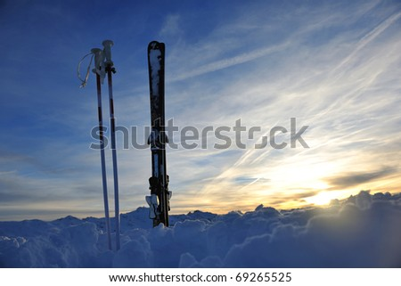 mountain snow ski with beautiful sunset in background - stock photo