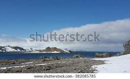 Mountain, snow, white cloud, sea and blue sky at Antarctica