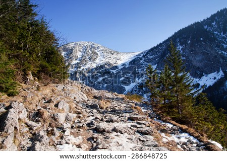 Mountain snowy landscape with rock path in Zakopane - stock photo