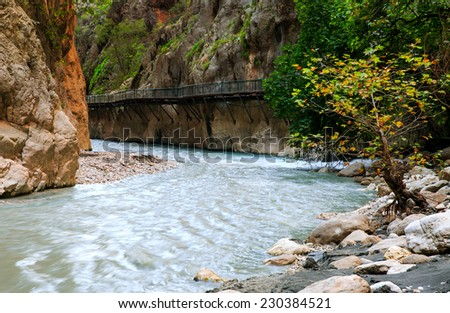 Mountain stream full of smooth rocks in Saklikent Gorge Canyon in Turkey  - stock photo