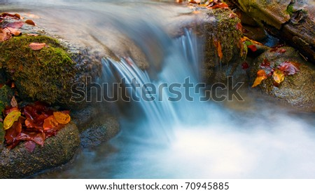 mountain stream in autumn time - stock photo