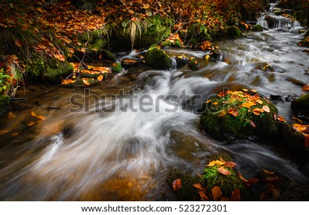 Mountain stream in autumn time, long exposure