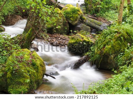 Mountain stream taken with long exposure - stock photo