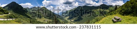 Mountain summer panorama with green Alps hills in background and relaxing place in foreground.Styria,Austria. - stock photo