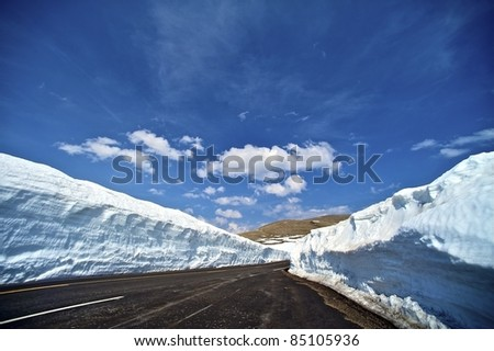 Mountain Summit Road - Rocky Mountains National Park, Colorado USA.  Roadside Snowfields. Clear Blue Sky. - stock photo