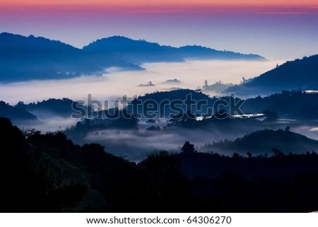 Mountain sunrise with morning fog at Cameron Highland, Malaysia. - stock photo