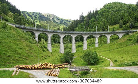 Mountain train Viaduct in the Swiss Alps. Switzerland
