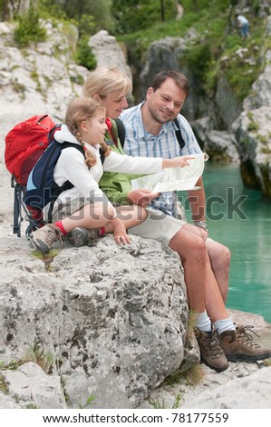 Mountain trek - family crossing through river