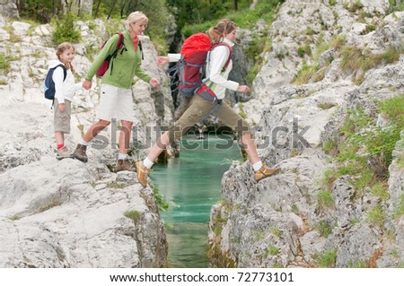 Mountain trek - family expedition - stock photo