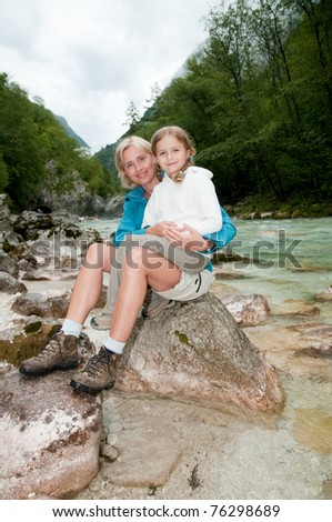 Mountain trek - little girl with mother on trek