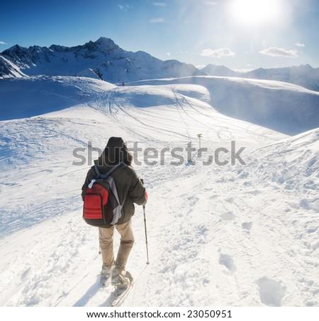 Mountain trekking in the winter - stock photo