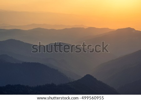 Mountain valley during sunrise. Natural landscape in the summer time