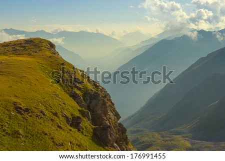 mountain valley in a mist - stock photo