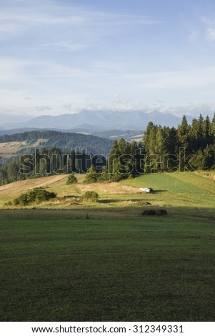 Mountain valley in Pieniny Mountains at morning in distance Tatra Mountains