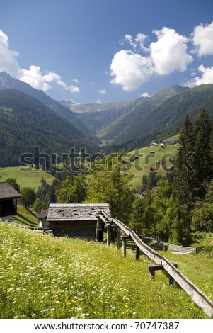 mountain valley village in austrian alps in summer by lesachtal in kaernten province - stock photo