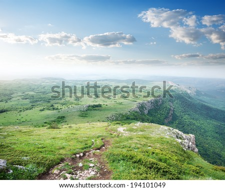 Mountain valley with green grass in spring