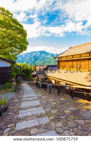 Mountain view at southern entrance of Magome town on the ancient, historic Magome-Tsumago Nakasendo trail in Kiso Valley, Japan. Vertical