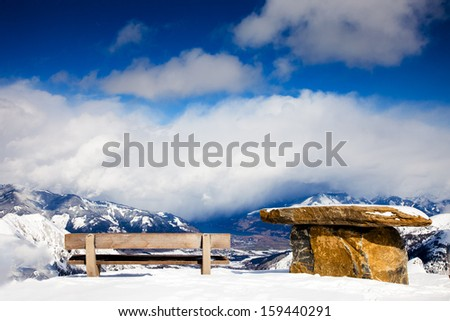 mountain view from the bench on the lookout - stock photo