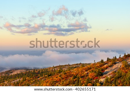 Mountain View of Trees in Autumn with Fog at Sunrise - stock photo