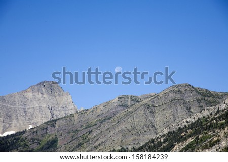 Mountain view with blue sky and moon background - stock photo