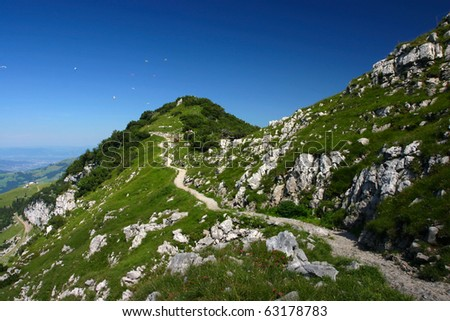 Mountain view with paragliders on the background in Appenzel (Switzerland) - stock photo