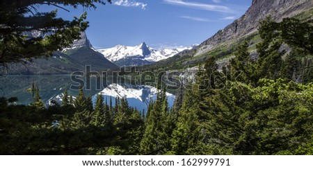 Mountain view with reflection, Glacier National Park, Montana, USA - stock photo