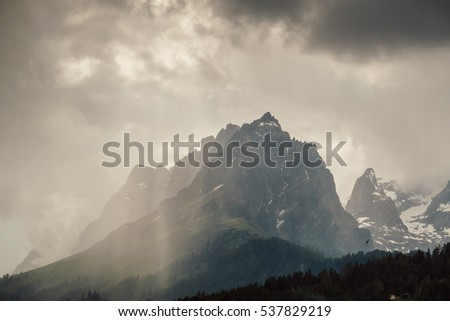 Mountain view with the ray of sun shining through the clouds
