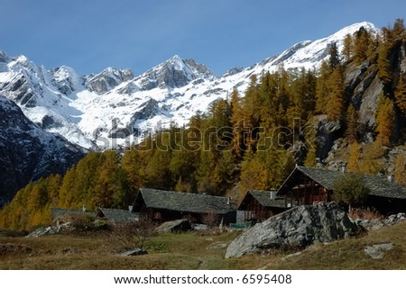 Mountain village during fall season; west Alps, Italy