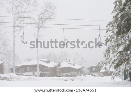 Mountain villas and a ski chairlift during a snow storm, Stowe, Vermont, USA