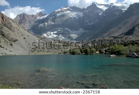 Mountain wall with lake on its foot. Tajikistan. - stock photo