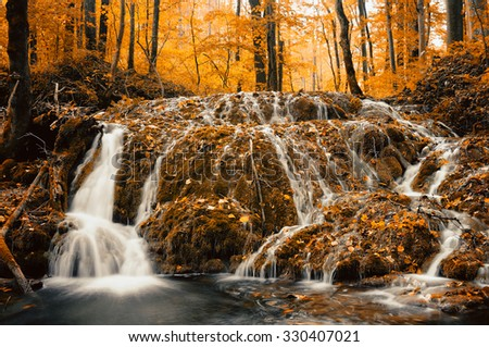 Mountain waterfall in late Autumn